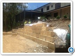 Blocks being fitted for a retaining wall on the Gold Coast