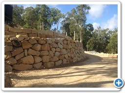Carved and natural rock wall construction