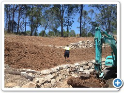 Rock retaining wall construction